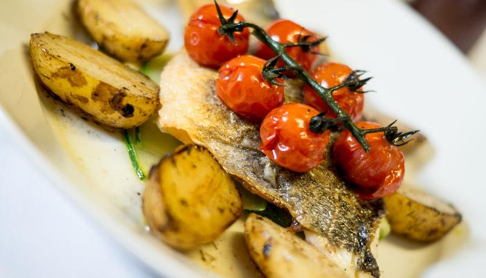 Fillet of nicely fried on sauteed potatoes & topped with grilled cherry tomatoes on the vine