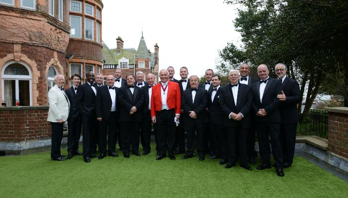 Freemasons dressed in tuxedos in the Burlington Hotel grounds